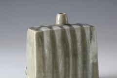Square Vase.  18 cm.  Celadon glaze over white marks. 2013